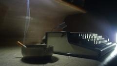 Old typewriter [Noir setting] cigar smoke slowmotion Stock Footage