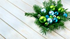 Christmas dinner table centerpiece with blue glitter ornaments Stock Photos