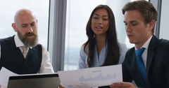 4k, Multi ethnic business people in city clothes meeting in a boardroom. Stock Footage