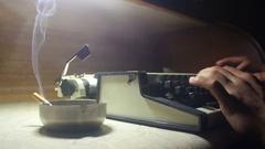 Old typewriter [Noir setting] cigar smoke Stock Footage