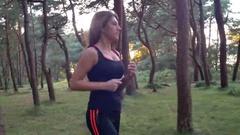Woman Runs Through the Trees Stock Footage
