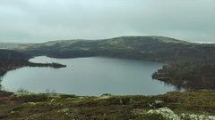 A small mountain lake in the tundra. Stock Footage