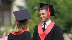 Couple of graduates enjoying life, hugging and turning around, true happiness Stock Footage