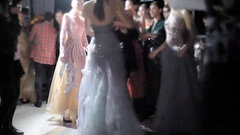 Models in sexy dresses lingerie after the show to congratulate the designer and Stock Footage