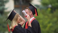 Smiling graduates talking, enjoying important day of their lives, bright future Stock Footage