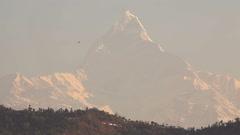 Machapuchare Peak Sunrise Paraglider Stock Footage