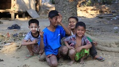 Poor children on the street. Poverty is a major issue in Burma. Myanmar Stock Footage