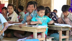 Burmese girls and boys in a local school during the lesson, Burma, Myanmar Stock Footage
