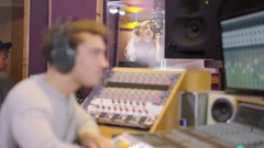 4K Portrait smiling music producer in recording studio Stock Footage
