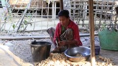 Local old woman working in the yard, Mrauk U, Burma. Myanmar Stock Footage