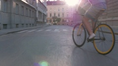 Behind young man swerving with his bicycle on the city street Stock Footage