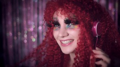 4k Disco Redhead Sexy Woman Wearing Pink Headphones and Dancing Stock Footage