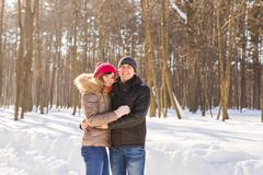 Happy Young Couple in Winter Park having fun. Family Outdoors. love Stock Photos