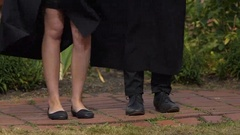 Male and female feet dancing at graduation party, students celebrating success Stock Footage
