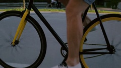 Closeup - Male pedalling fixie wearing casual men shoes in the city center Stock Footage