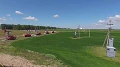 Flying over working oil pumps at sunny day, 4k Stock Footage