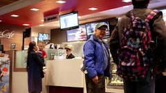 Motion of people ordering food and chatting with friend at mcdonalds Stock Footage