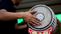 Musician playing 2 faces drum, Thai traditional musical instrument. Stock Footage
