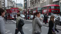 Traffic and red busses in London Stock Footage