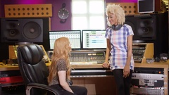 4K Portrait 2 young women in recording studio working at the mixing desk Stock Footage