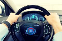 Close up of man driving car with volume level icon Stock Photos