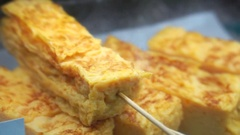 Tamakoyaki, Sweet egg grilled tamako yaki in Japanese food Stock Footage
