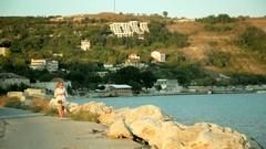 Walking along the promenade at sunset Stock Footage