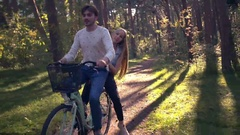 Joint Bike Ride in the Forest Stock Footage