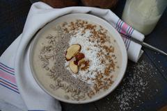 Vegan Breakfast banana smoothie with Chia, coconut, nuts, oatmeal. Stock Photos
