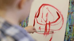 A small child draws with his left hand. The kid learns to draw. Stock Footage