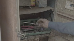 A mechanic trying to find the right tools Stock Footage