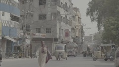 A small van comes and stops, as people get off Stock Footage