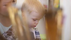 Little boy draws on canvas with paints. Closeup. Stock Footage