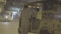 Rickshaw guy sits inside and talks Stock Footage