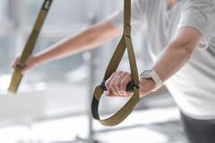 Close up of womans arms holding sport equipment Stock Photos
