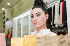 Woman in the clothing store Stock Photos