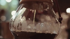 Close up view of pouring hot brewed coffee, visitor of the cafe on the Stock Footage