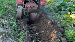 Tractor plowing potato field Stock Footage