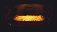 Baked lasagna in the oven. Open the oven check the preparing and close Stock Footage