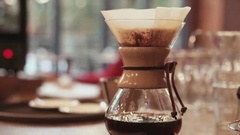 Coffee brewing process, flow of strong, hot coffee through the filter into the Stock Footage