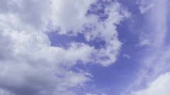 Video of fast moving clouds in a blue sky Stock Footage