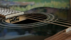 Vibration of strings on an acoustic Guitar Stock Footage