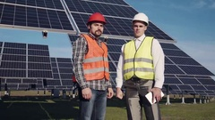 Two solar power engeneers looking in camera Stock Footage