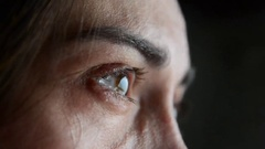 The woman is crying. Close-up eyes and tears. Stock Footage