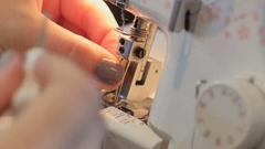 Seamstress works on the sewing machine Stock Footage