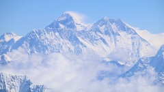 Mount Everest himalaya range panorama view flyby aerial shot crystal clear peak Stock Footage