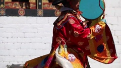 Bhutan dancer on a festival in a monastery with drums Stock Footage