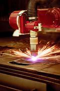 CNC Laser plasma cutting of metal, modern industrial technology. Stock Photos