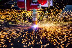 CNC Laser plasma cutting of metal, modern industrial technology. Kuvituskuvat