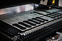 CNC Laser cutting of metal, modern industrial technology. Kuvituskuvat